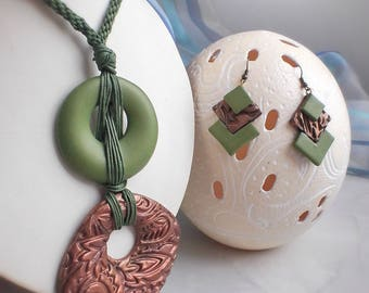 Unusual jewelry, pendant green with bronze and earrings.