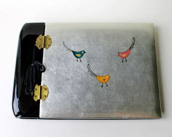 Vintage lacquer photograph album. Asian 1960's photo album with birds by Talaad. Lacquered oriental silver leaf front. Hinged photo album.