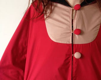 Waterproof Cape with a large red hood hot and dusty pink