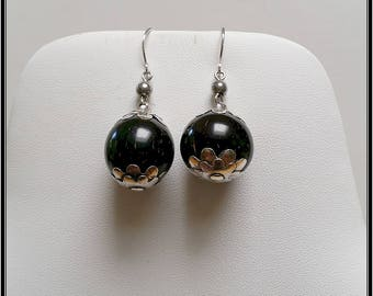A  pair of antique silver nut earrings