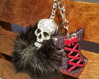 Beautiful red and black holographic glitter corset on a rhinestone skull pompom keychain!!