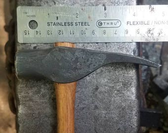 Hand forged claw carpenters hammer. Blacksmith made.