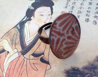 Bronze Adjustable ring and Japanese paper.