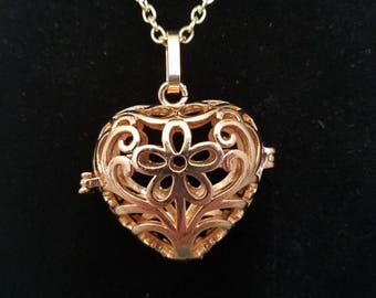 Gold fillagree heart locket