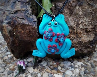 Blue floral polymer clay frog necklace.