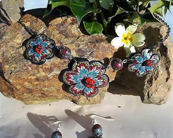 Set of Burgundy, blue and pink flowers with their polymer clay Ladybug