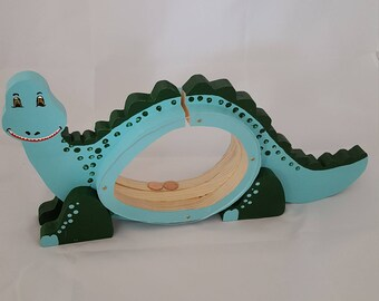 Dinosaur piggy bank, painted in blue and green from solid pine wood