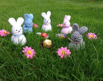 Cute bunnies hand knitted to cover a variety of chocolates or a small gift. Ideal for a Christening or baby shower present.