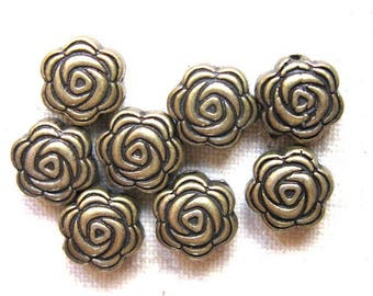 20 metal beads 8 mm flower shape.
