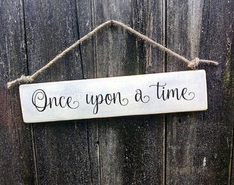 Handmade wooden sign with the words 'Once upon a time'.