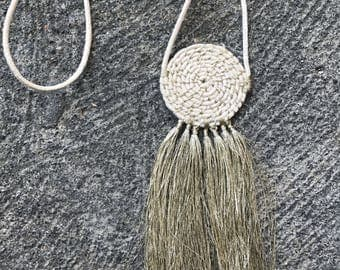 The Golden Sky - woven circle pendant with tassels