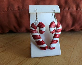 Red Christmas candy cane dangle earrings
