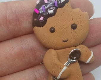 Chewed gingerbread man necklace
