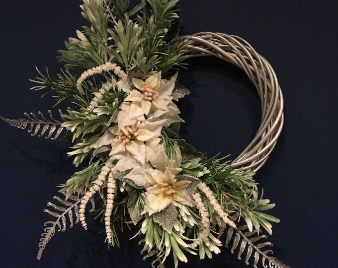 Herb and poinsettia winter wreath