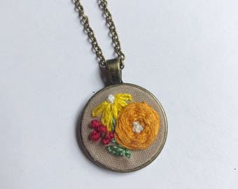 Embroidered floral pendant