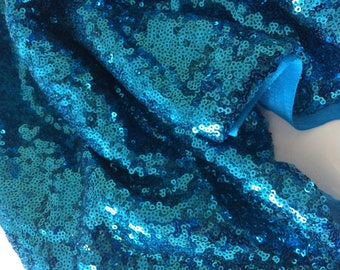 Fabric has turquoise blue sequin evening dress