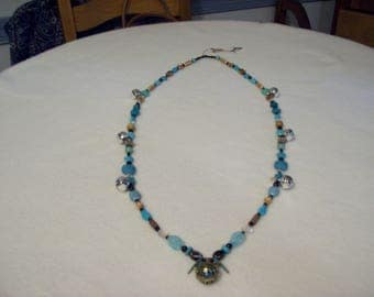 """Horse Rhythm Necklace, 52"""", Turquoise/Black With Charm Containing a Harmony Ball"""