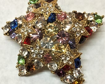 This is the most Beautiful Brooch I own! Vintage Star of Many Colors with 5 smaller stars. Swarosvski Multi Color Pin