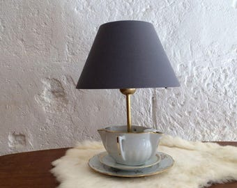 Lamp in old China, teapot, teacup.