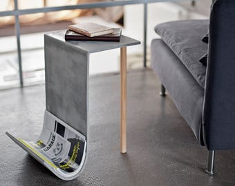 Concrete magazine rack with shelf