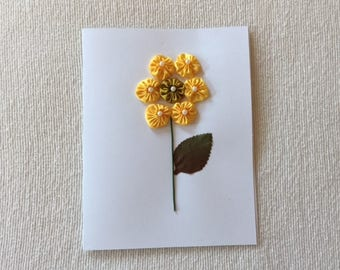 Greeting Card with a Yellow Flower Design
