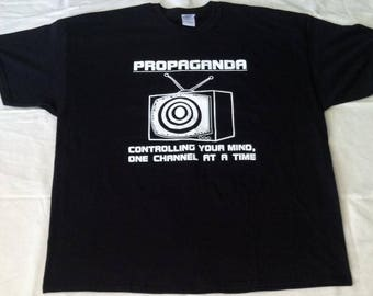 Propaganda Political satire t-shirt. comfortable 100% cotton Gilden high quality screen print that will last many many washes.