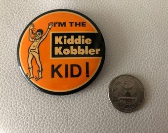 """Vintage 1980's """"Kiddie Kobbler"""" pinback button"""