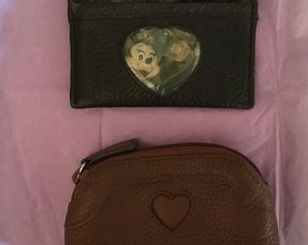 Two small Brighton coin purses- one black, one brown