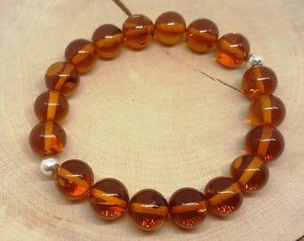Amber bracelets.Cognac color amber.