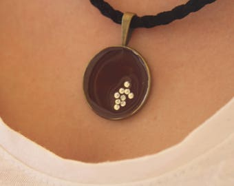 necklace with crystals and liquid glass