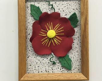 Frame with red flower