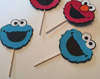 12 count Elmo and Cookie Monster cake toppers