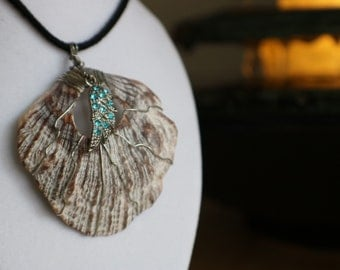 Angel charm wire wrapped sea shell necklace