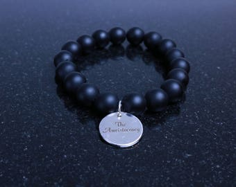 "12MM Men's Matte Black Onyx Bracelet with"" The Awristocracy"" Round Silver Metal Charm"