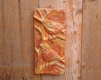 Chickadee ceramic tile in golden green finish.