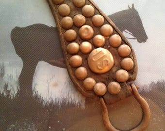 Antique WW1 era US Cavalry leather with US brass rosette and 32 brass studs; hooks for saddle attachment; military collectible US Army Horse