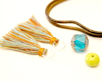 2 pompons Turquoise, mustard, Brown copper, silver, ring Tassel