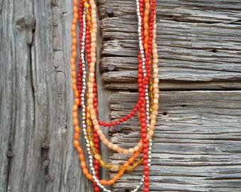 Red, silver, yellow and orange beaded necklace