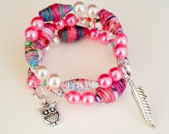 Memory wire spiral Wire Bracelet with pink and white glass beads and paper beads and silver pendants