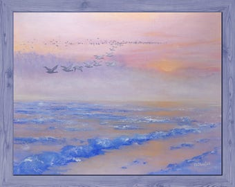 Wild geese flock in flight during sunset