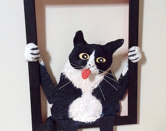 Framed black cat, paper mache and acrylic.