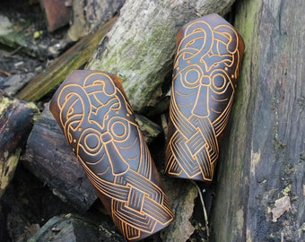 Pair of leather Bracers real decoration of stylized head
