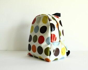 kindergarten backpack / child in coated multicolored dots