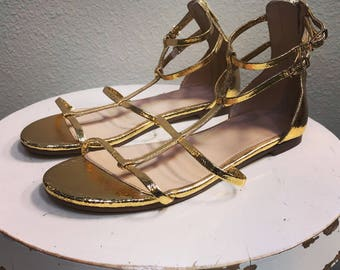 Gold leather gladiator sandals. Size 6.