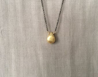 Brushed Gold Teardrop on Black Faceted Chain