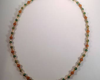 Orange Beaded Necklace with Green Gems and Gold Details