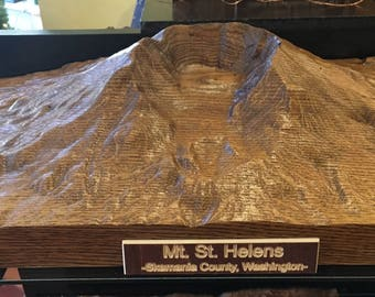 "Mt. St. Helens replica carved out of an old aged oak beam.   20"" x 12"""