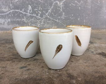 3 cups made of ceramic with gold plated spring