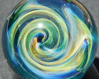 Gold and Silver fumed spacey swirls glass marble.