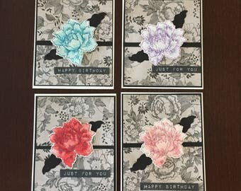 Happy Birthday. Set of 4 Cards, Beautiful center flowers in different colors, tied with black  ribbon, gift idea, female, friends, co-worker